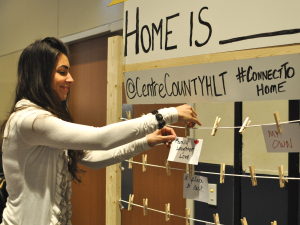 Home Is _____. display with community member